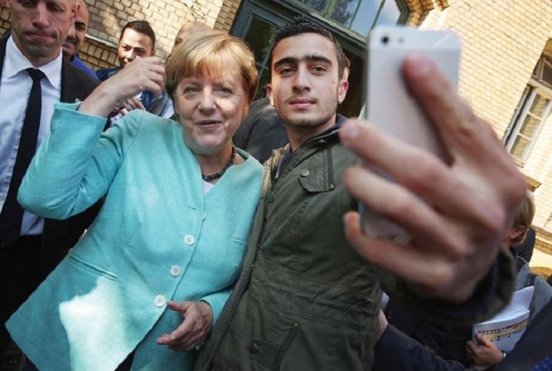 Беженцы в Германии с А. Меркель
